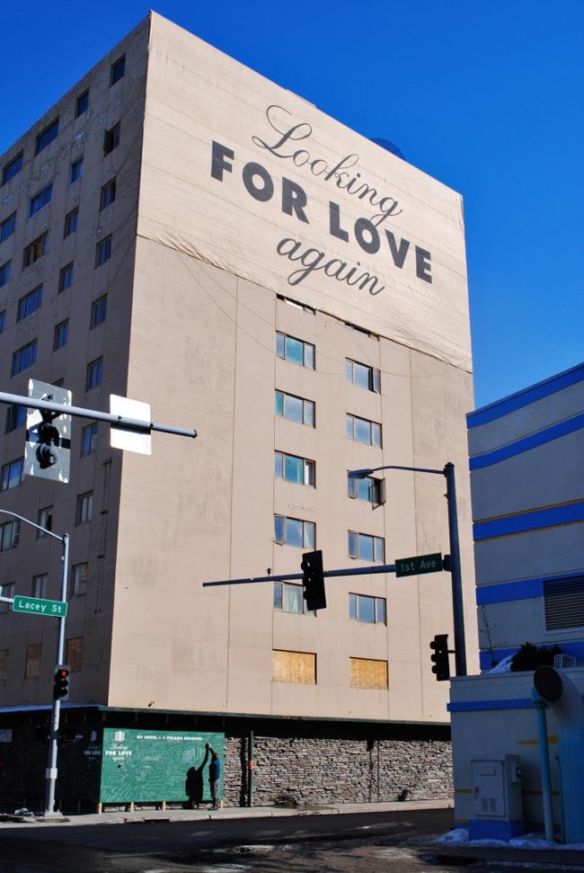 """Dự án """"Thêm một lần nữa tìm kiếm tình yêu"""" do Candy thực hiện theo đơn đặt hàng của một tổ chức nghệ thuật tại thành phố Fairbanks, Alaska (Mỹ). Tòa nhà từng là nhà chung cư nay bị bỏ hoang. Tấm biển lớn của Candy với dòng chữ """"thêm một lẫn nữa tìm kiếm tình yêu"""" biến tòa nhà bị quên lãng trở thành cột mốc cảm xúc trong thành phố. Dưới góc tường là tấm bảng xanh cho phép mọi người chia sẻ những ý tưởng của họ về tương lai tòa nhà. Những thông tin này sẽ được chủ đầu tư và thành phố sử dụng."""